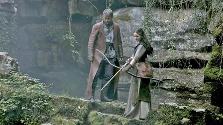 Duran Fulton Brown as Hunter and Sophie Skelton as Ren in a scene from the series.