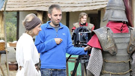 Actors are briefed ahead of their next scene in the medieval village set.