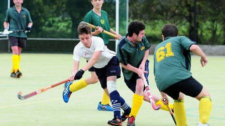 Matt Evans attempts a shot under heavy pressure from the Letchworth defence