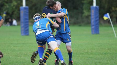 Andy Clark and Joe Baker tie up an opponent