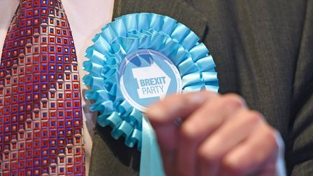 A rosette on the jacket of Brexit Party leader Nigel Farage. Photograph: Joe Giddens/PA.