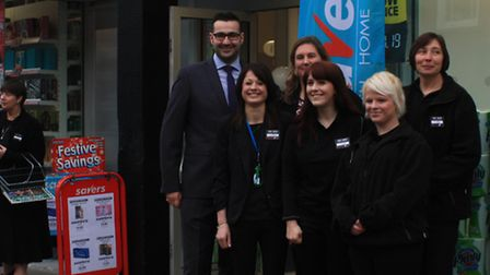 Area manager Richard Adams with staff at the newly opened Savers Store by Clive Porter