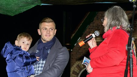 Arsenal star Jack Wilshere, with son Archie, shares a joke with Harpenden Town Mayor Cllr Mary Mayna