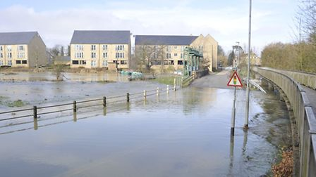 Floodwater in Mill Lane. Picture: HELEN DRAKE.