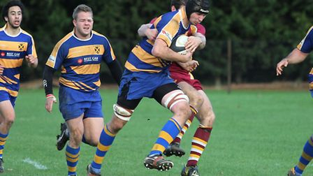 Jack Middleton, pictured against Old Haberdashers, tries to escape his man. Picture: Danny Loo