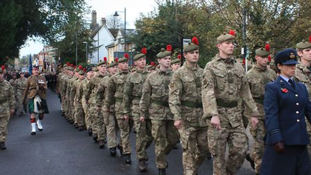 Hundreds gather as servicemen march through town. Credit: Clive Porter.