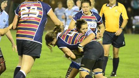 Pack leader Holly Watson sets up a quick ruck for the Saints.