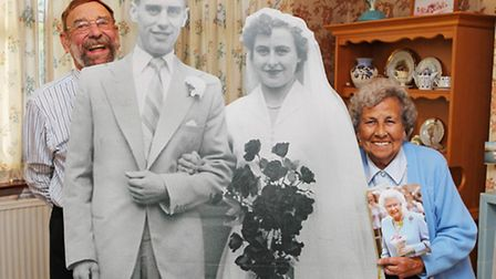 Kenneth and Joan Sheppard celebrate their diamond wedding anniversary with a giant cutout of a pictu