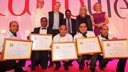 Altaf Hussain from Royston (Bottom row, second from right) at the Lancaster Hotel in London receivin