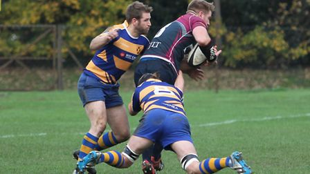 Jeremy Walmsley hangs on in the tackle