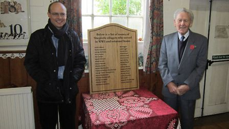 Shepreth parish councillors Richard Handford and Cyril Kenzie unveiling the plaque at Shepreth Villa