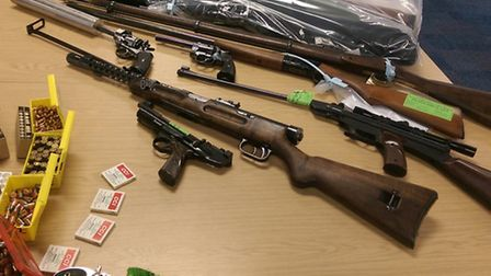 Some of the weapons and ammunition handed in during the Cambridgeshire police firearms amnesty.