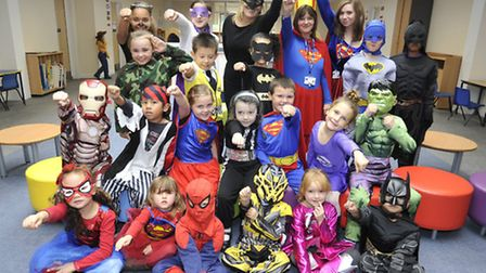 Staff and pupils at St Johns Primary School, Huntingdon, dressed as superheroes.