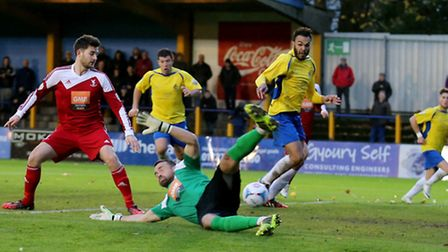 Geoff Mitchell touches home after Craig Ross is unable to stop the ball. Picture: Leigh Page