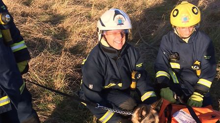 Firefighters with Ollie after the rescue.