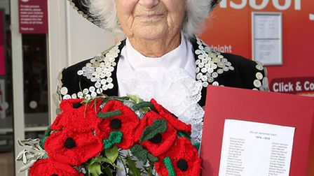 Joy Lintill knitted a wreath of poppies to commemorate the 14 servicemen from London Colney who are