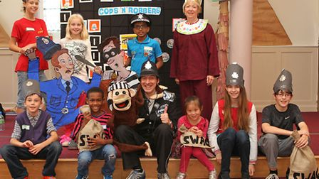 Some of the Cops and Robbers Holiday Club with leader John Hardwick (front centre) and Gill Grainger