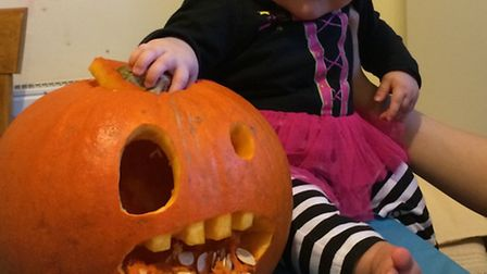 Four-month-old Sienna Lambert, of Huntingdon, in her first halloween costume with her first carved p