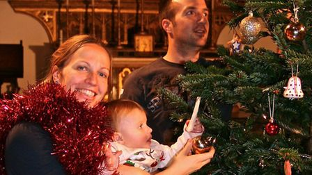 Members of the St Saviour's Family prepare for the Christmas Tree Festival