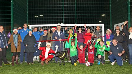 Local councillors and children are joined at the opening of the new artificial football pitches by s