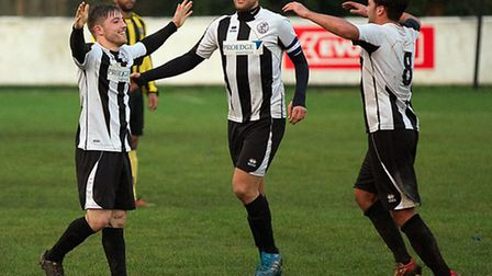 St Ives players, from the left, Ben Seymour-Shove, Jordan Lambert and Jack Higgs celebrate a goal in