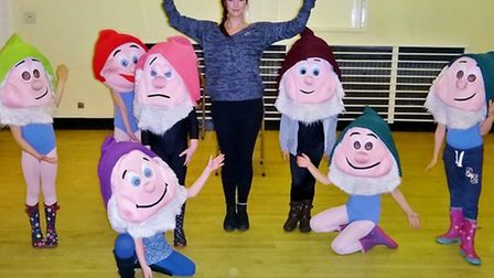 Sophie Massie as Snow White in rehearsal with one team of dwarfs