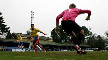 John Frendo pounces on a lose ball in the penalty area. Picture: Leigh Page
