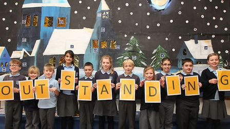 Pupils of Skyswood primary school celebrate their recent outstanding OFSTED report in front of their