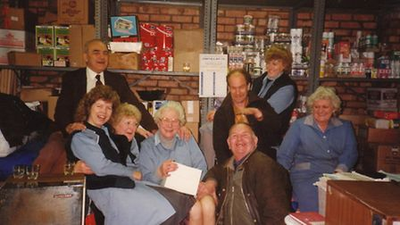 Cecil Whetstone, rear left, with staff at his shop in St Ives.