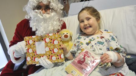 Olivia Penfold from Needingworth with Father Christmas.