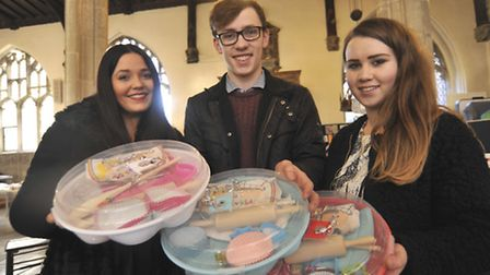 From left, Emily Turner, Tom Fletcher, and Sian Unwin, from Longsands Academy, with their cake makin