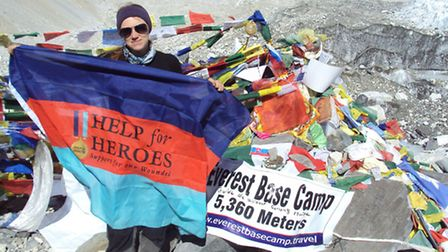 Lucy Peat at Everest base camp with her Help for Heroes flag.