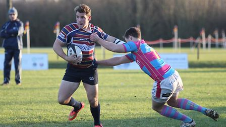 Max Wilkins tries to slip a tackle