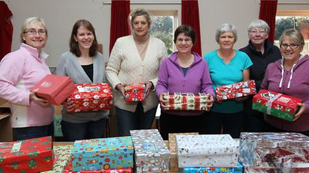 Volunteers for Operation Xmas Child in Colney Heath church hall help get the presents ready L-R Mich