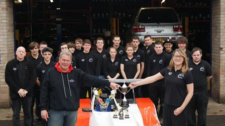 The Huntingdonshire Regional College Race Team pictured with driver Howard Payne.