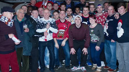 St Ives Town players and supporters sported Christmas jumpers for their trip to Egham on December 6.