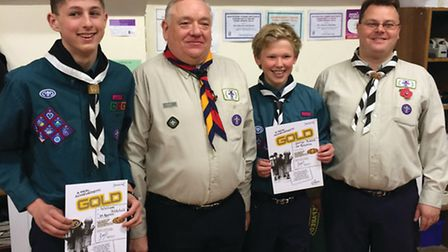 Scouts William Mitchell, left, and George Adam with Royston scouting district commissioner Geoff Kav