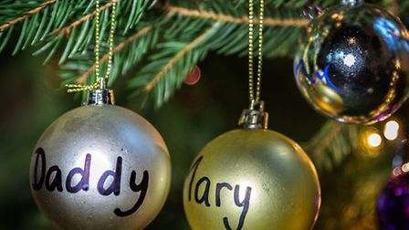 Personalised baubles hanging from the tree.