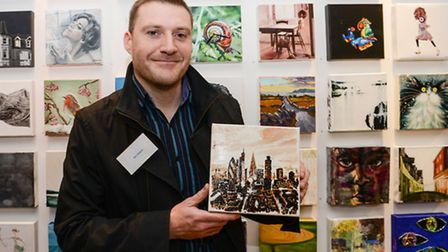 Ben Askem at the exhibition with his painting - photo Deborah Ram