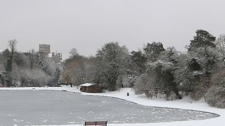 A frozen Verulum lake with St Albans Abbey in the distance