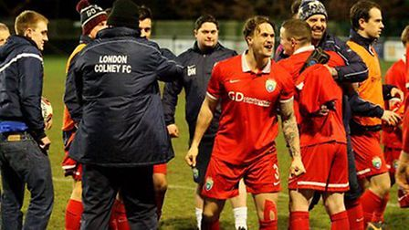 London Colney players and staff celebrate their semi-final win. Picture: James Whittamore