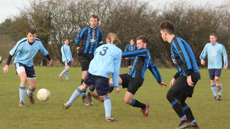 Harpenden Colts OB's Alex Dennehy scores against Wheathampstead '90.
