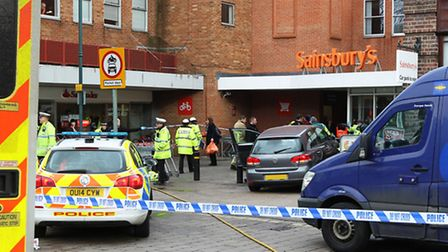 The car which crashed into a pedestrian can be seen outside Sainsbury's as emergency services attend