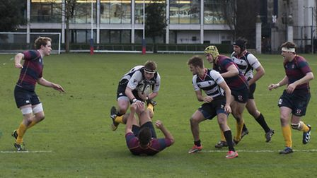 Action from Harpenden's win over HAC in London 2NW.