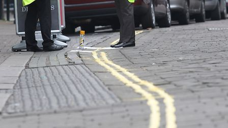 Double yellow lines are painted along Market Place in order to stop people parking in unmarked bays
