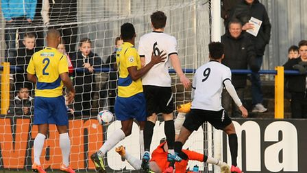 Tom Coulton is beaten at his near post in the third minute as Boreham Wood take the lead. Picture: L