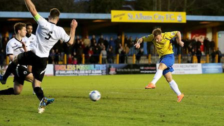 Charlie Smith has a crack through a crowded Borehan Wood goal mouth. Picture: Leigh Page
