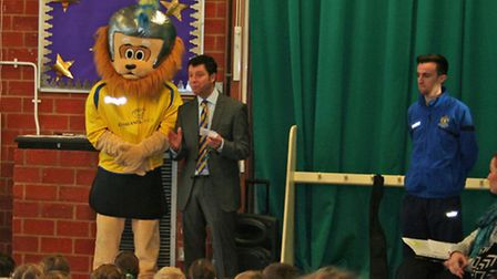 St Albans City co-owner Lawrence Levy, City Youth trustee Sam Mardle and Sammy the Saint give an ass