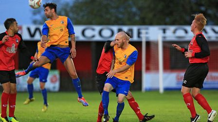 Kaan Fehmi wins wins a header for Royston at Aylesbury