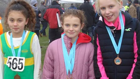 Hunts AC athletes Angel Lyden, Sophie Worral and Lizzie Harrison who won the team bronze in the Unde